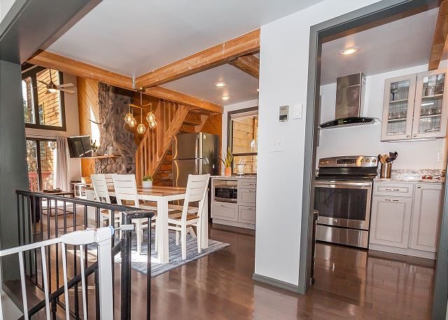 The second level features the living, kitchen and dining areas, plus another deck.