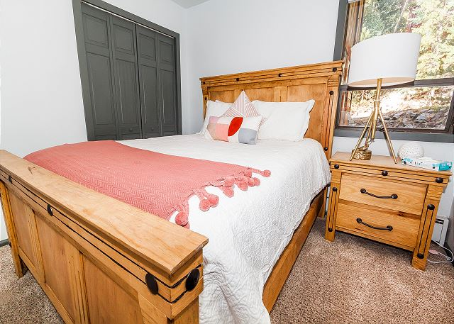 The second guest bedroom is on the first level and features a queen-sized bed.