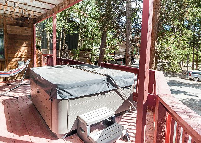 The wraparound deck on the first level offers treed views, seating and a private hot tub.