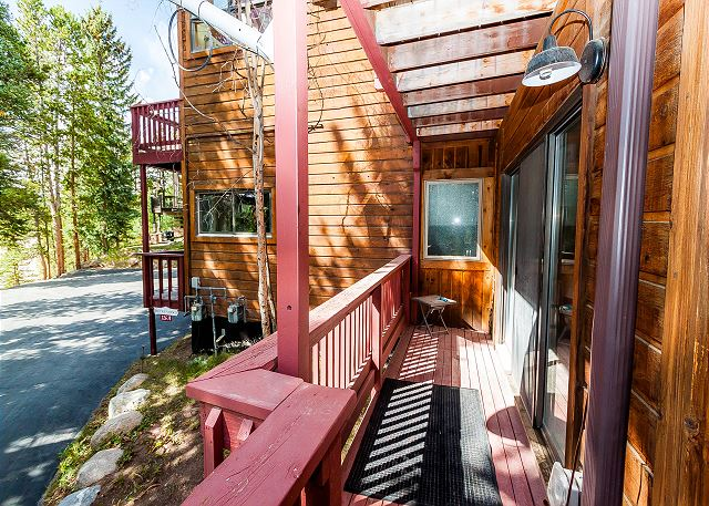 The first guest bedroom has its own access to the wraparound deck.
