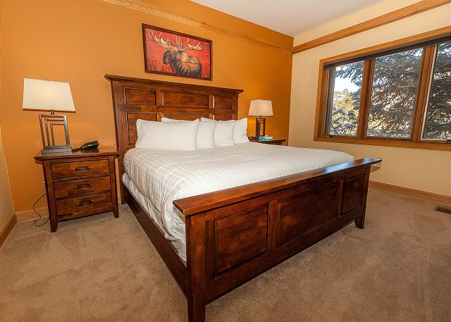 The first master suite features a king-sized bed on our Ivory White Bedding program and a flat screen TV.