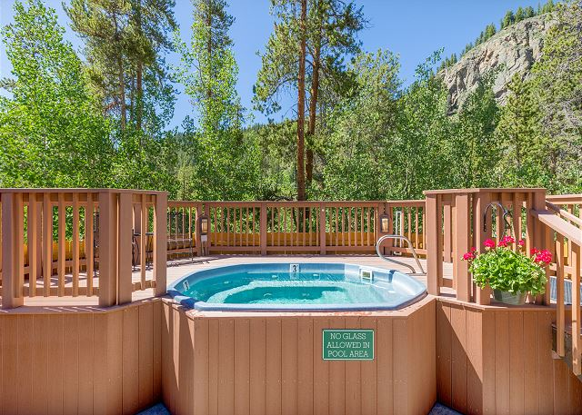 The shared hot tub is located directly across from the vacation rental.