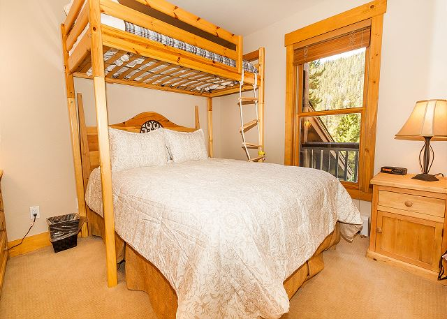 The guest bedroom features a twin-over-full bunk bed.
