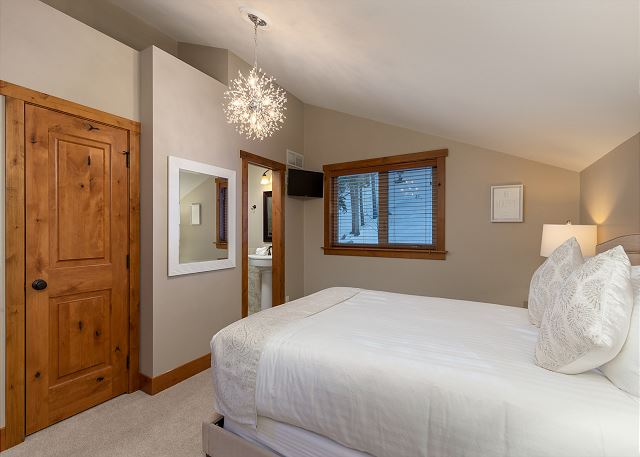 The second master suite is upstairs and features a queen-sized bed and a flat screen TV.