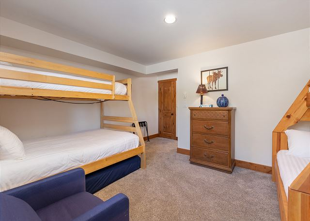 The third guest bedroom is downstairs and features two twin-over-full bunk bed and a twin-sized mattress.