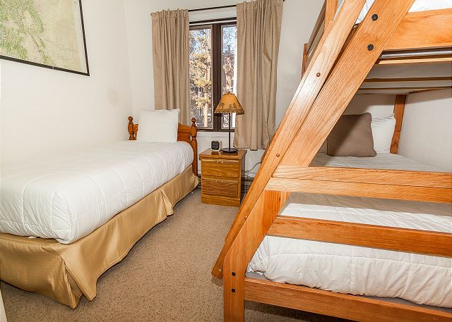 The second guest bedroom features a twin-sized bed and a twin-over-full bunk bed.