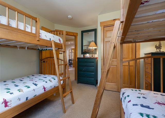 The first guest bedroom is on the main level and features two twin-sized bunk beds and a flat screen TV.