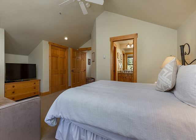 The second master suite is upstairs and features a queen-sized bed, a queen-sized sleeper sofa and a mounted flat screen TV.