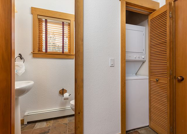 There is a half bath on the main level and private laundry.
