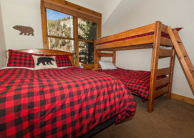 The second guest bedroom is upstairs and features a queen-sized bed and a twin-sized bunk bed.