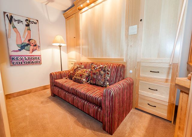 The third bedroom features a queen-sized Murphy bed and a flat screen TV.