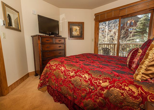 The second bedroom features a queen-sized bed, a flat screen TV and its own private balcony.