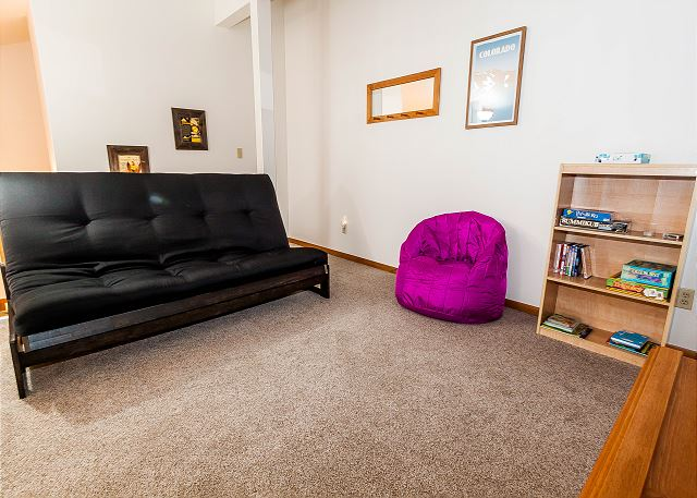 The upstairs loft has a full-sized futon, a flat screen TV and a DVD player.
