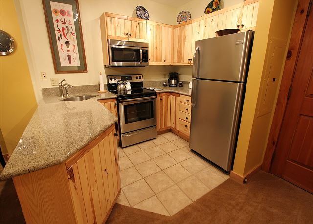 Kitchen features granite countertops and stainless steel appliances.