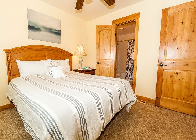 The second guest bedroom features a queen-sized bed and shares a bathroom with another bedroom.