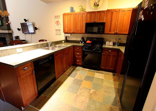 Kitchen features granite countertops.