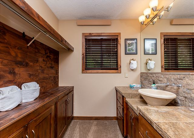 Master bathroom features granite countertops and single sink vanity with lots of counter-space.