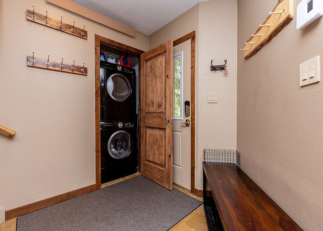 Entryway just off the kitchen with washer and dryer.