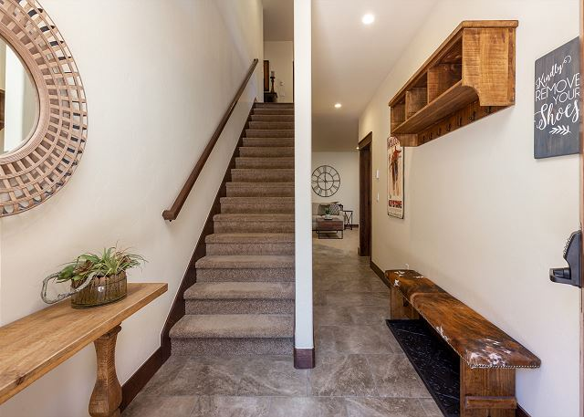 The entryway has a bench and hooks for your convenience in your daily activities.