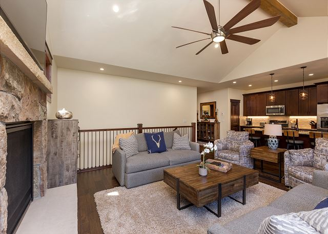 The living room features a stone fireplace that you can enjoy after a long day skiing or exploring Keystone.  The main living room also has large windows to see the stars at night and amazing views during the day.