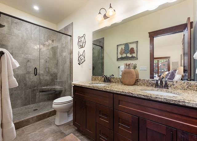 The master bath features a beautiful walk-in shower and dual sinks.
