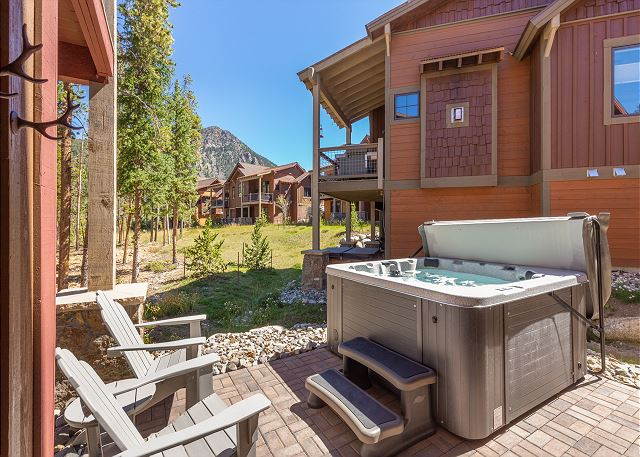 The lower patio is also where you will find the private hot tub for unwinding after a day of hiking in the summer or skiing in the winter.