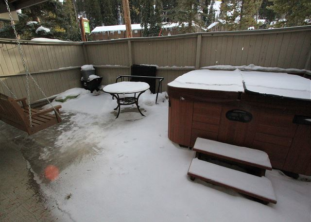 The private hot tub is located on the lower level patio.