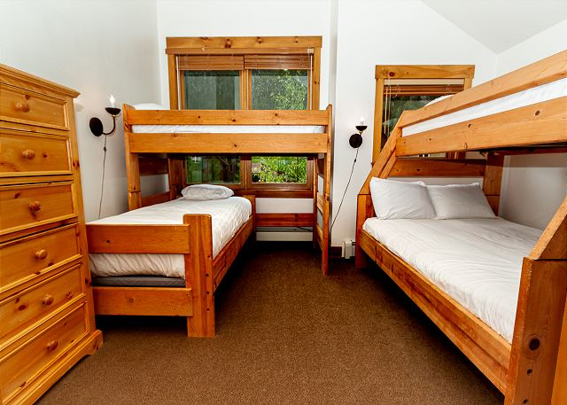 The second upstairs guest bedroom features two bunk beds and a jack-and-jill bathroom.
