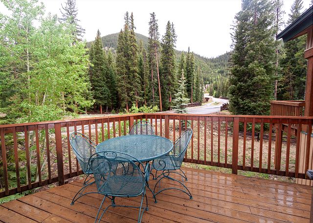 Spacious private deck with a gas grill and seating area.
