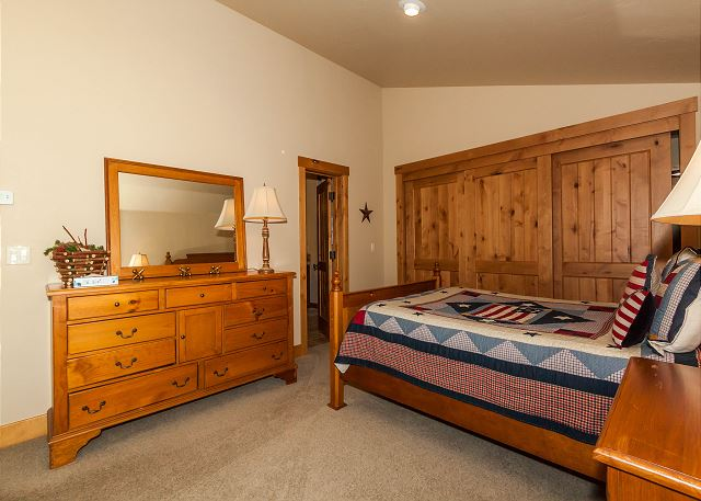 The first guest bedroom is upstairs features a queen-sized bed and a twin-sized bed with a twin trundle underneath. It also has its own access to the guest bathroom.
