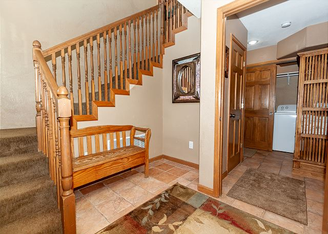 The entryway with laundry room nearby.