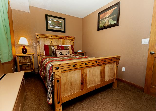 The lower-level guest bedroom with a queen bed.