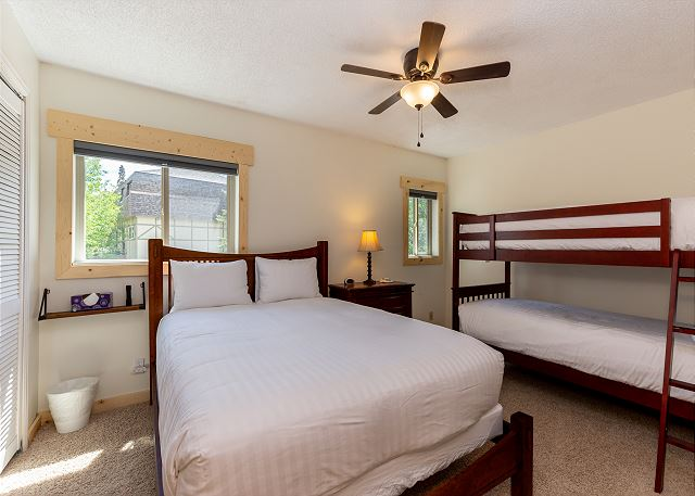 The second bedroom has a queen bed and a twin bunk bed.