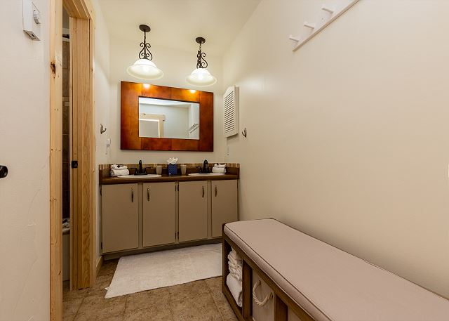 The upstairs bathroom features double sink vanity, granite countertops, and a shower/tub combination.