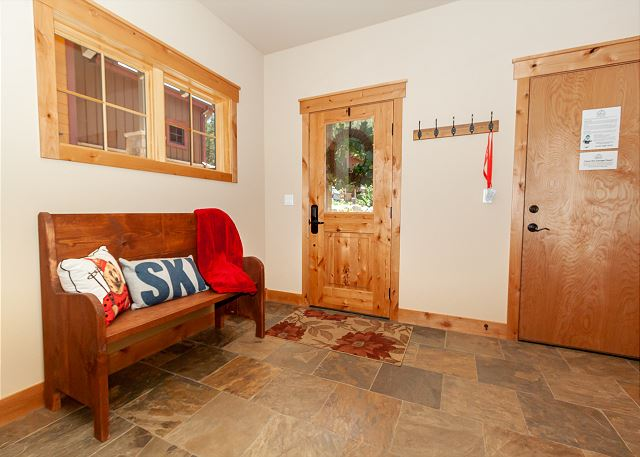 The entryway with a bench and hook.