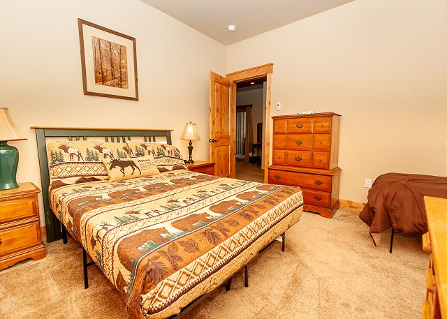 The second guest bedroom features a queen and a twin bed.