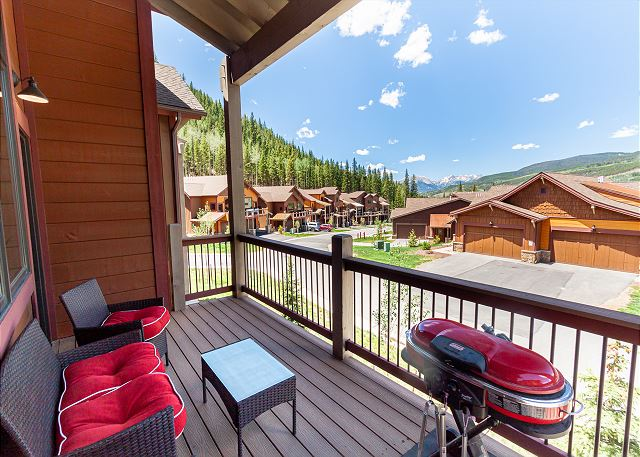 The private balcony boasts spectacular views, seating for 4, and a gas grill.