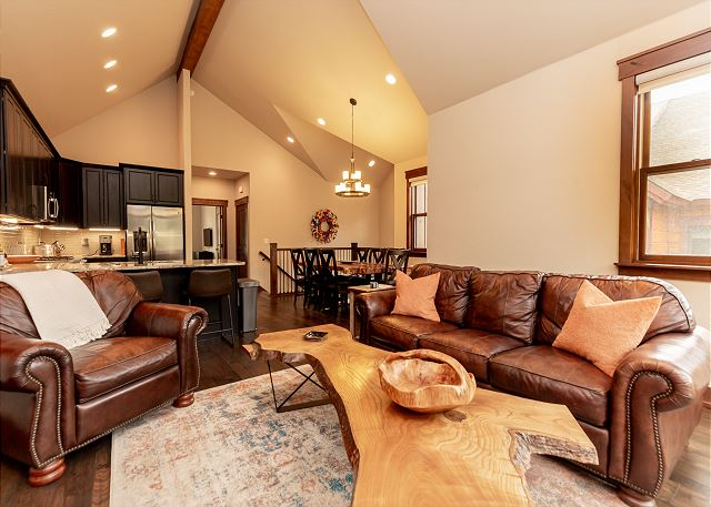 Living Room with gas fireplace, access to the private deck, and spectacular views.