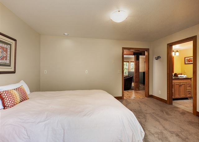 The first guest bedroom has access to the deck in the back and the guest bathroom.