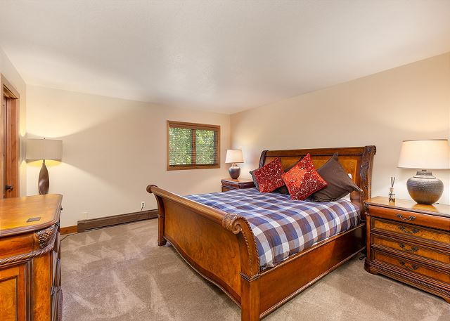 The second master bedroom features a king-sized bed.
