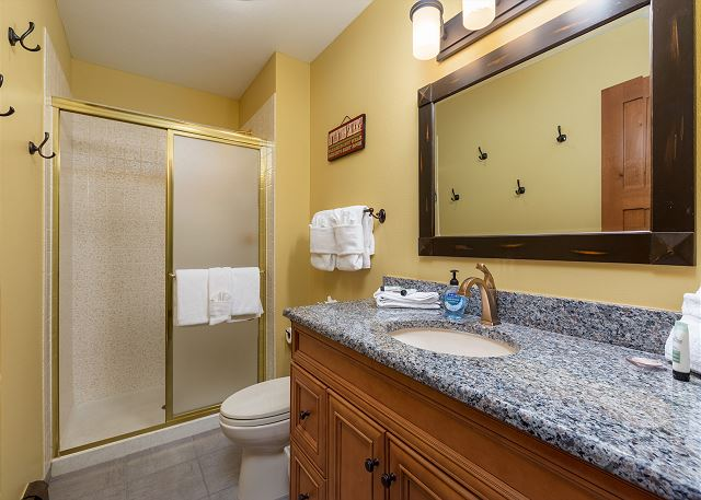 The second master bathroom has a single sink vanity with granite and a walk-in shower.