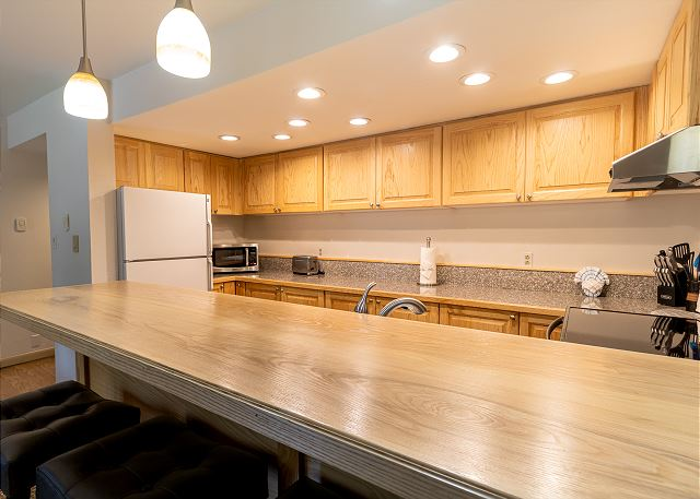 The kitchen has a breakfast bar with seating for 4.