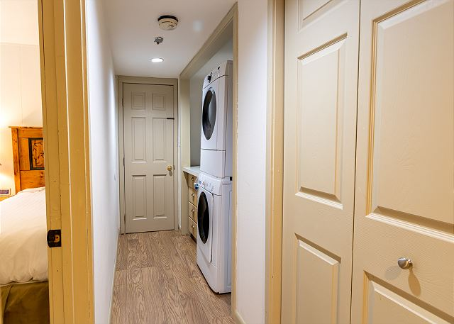 The private laundry has a full-sized washer and dryer.