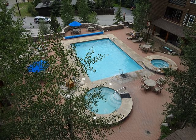 View of the shared pool and hot tubs from balcony.
