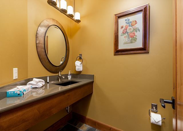 The guest half bathroom is on the main level.