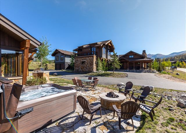 The patio features a hot tub, a natural gas grill, a natural gas fire pit, and plenty of seating to relax after a long day of adventure.