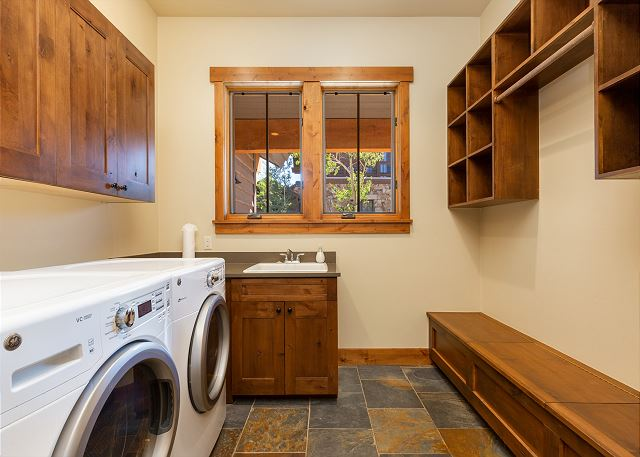 The laundry room features high efficiency appliances, an extra sink, and will soon have a ski-equipment dryer to accommodate up to 24 pieces of equipment.