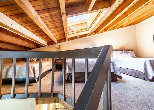The loft features three queen-sized beds and a flat screen TV.