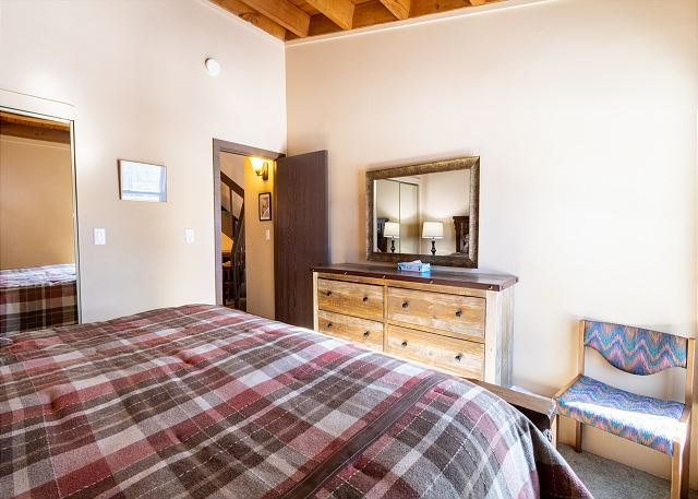 The bedroom features a king-sized bed.