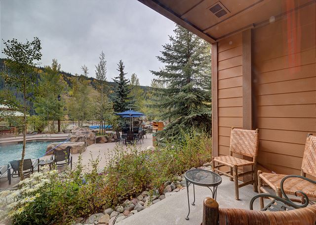 The private patio offers convenient access to the outdoor amenities with slope views.